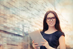Young Woman with Tablet Out in the City Stock Photo