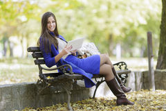 Young woman with tablet in park Stock Photo