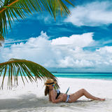 Young woman with tablet pc at the beach Stock Photos