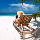 Young woman with tablet pc at the beach Royalty Free Stock Photo