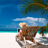 Young woman with tablet pc at the beach Royalty Free Stock Images