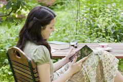 Young woman with tablet PC i Stock Photo