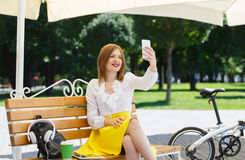 Young woman with tablet pc in the park Stock Image