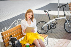 Young woman with tablet pc in the park Stock Images
