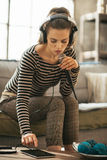 Young woman with tablet pc singing karaoke Royalty Free Stock Photography