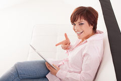Young woman with tablet Royalty Free Stock Images