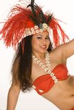 Young woman in Tahitian feather headdress. Islander young woman in Tahitian dancing feather headdress Royalty Free Stock Images