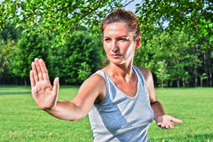 Young woman during tai chi exercise in the park Royalty Free Stock Images