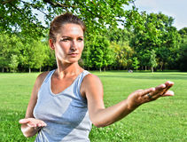 Young woman during tai chi exercise in the park Stock Photography