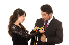 Young woman tailor designer taking measures of Royalty Free Stock Images