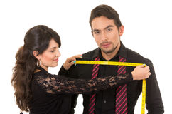 Young woman tailor designer taking measures of Royalty Free Stock Image