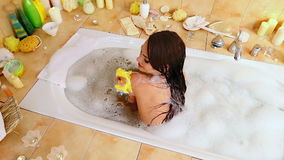 Young woman take bubble  bath. Top view stock video footage