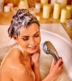 Young woman take bubble  bath Royalty Free Stock Images