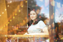 Young woman take a fun at the restaurant. Beauty adult dreaming girl looking through window Stock Photo