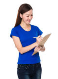 Young woman take note on clipboard Stock Photos