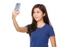 Young woman take selfie on mobile phone Stock Photography