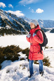 Young woman take a walk on winter mountain slope (Big Almaty Lak Stock Photography