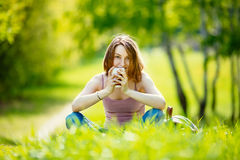Young woman with takeaway coffee outdoors Royalty Free Stock Photography