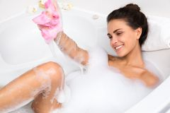 Young woman takes bubble bath Royalty Free Stock Images