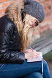 Young woman takes notes. The February stroll with a young woman Royalty Free Stock Photography