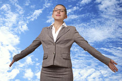 Young woman takes off into the sky. Successful business woman soars to the heavens Royalty Free Stock Image