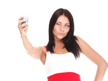 Young woman takes photos using her mobile phone Royalty Free Stock Photo
