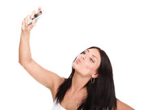 Young woman takes photos using her mobile phone Royalty Free Stock Photos