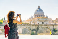 Young woman takes a picture of Cathedral of St. Peter in Rome Royalty Free Stock Photography