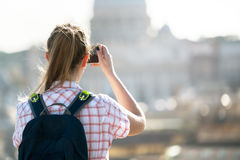 Young woman takes a picture of Saint Peter  Cathedral Stock Photos