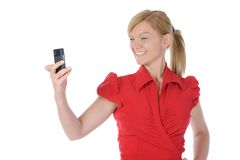 Young woman takes a picture to your phone Stock Photos