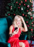 Young woman takes selfie by modern smartphone royalty free stock images