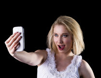 Young woman takes a selfie Stock Photography