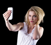 Young woman takes a selfie Stock Photos