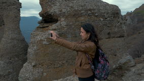 A young woman takes on the smartphone with the stock video footage