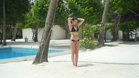 Young woman takes tropical shower in luxury resort stock video
