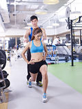 Young woman taking aerobics lesson. Young women doing aerobics in gym, guided by trainer Stock Images