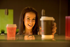 Young woman taking away a coffee Royalty Free Stock Photography