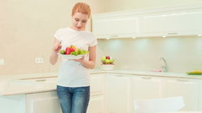 Young woman taking big plate with vegetables stock video