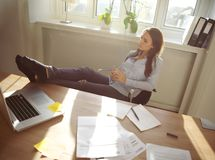 Young woman taking a break from work Royalty Free Stock Photo