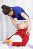 Young woman taking care of grandmother Stock Photo