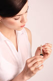Young woman taking care of her nails Royalty Free Stock Images
