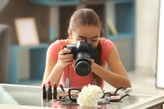 Young woman taking closeup pictures. Of makeup kit Royalty Free Stock Image