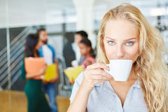 Young woman taking coffee break Royalty Free Stock Photos