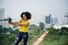 Young woman taking a cute selfie in the cityscape royalty free stock photos