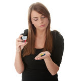Young woman taking drugs Royalty Free Stock Photography