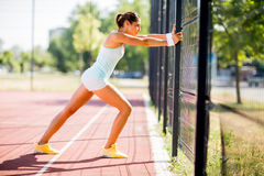 Young woman taking exercise Royalty Free Stock Image