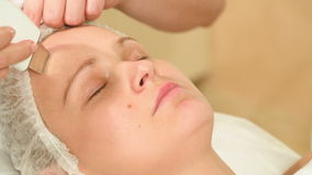 Young woman taking facial treatments of ultrasonic stock video
