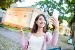 Young woman taking image by mobile phone in Macao Royalty Free Stock Photography
