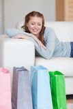 Young woman taking a moment off on her couch after a shopping Stock Images