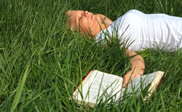 Young woman taking a nap outside Stock Image